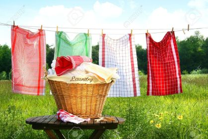 3305372-Towels-drying-on-the-clothesline-with-laundry-basket-Stock-Photo