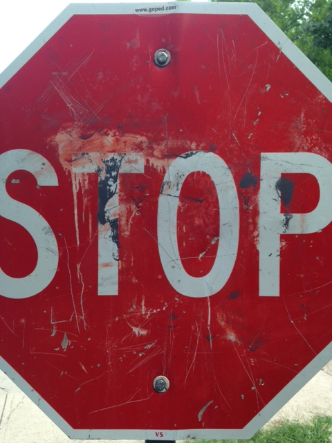 Battered STOP sign